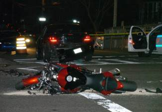 shooting victim hits motorcyclist