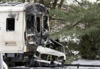 widow sues over train crash